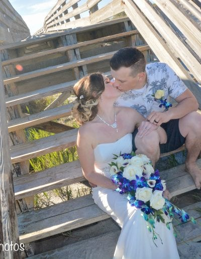 Wedding couple on wooden stairs at Ponce Inlet Beach