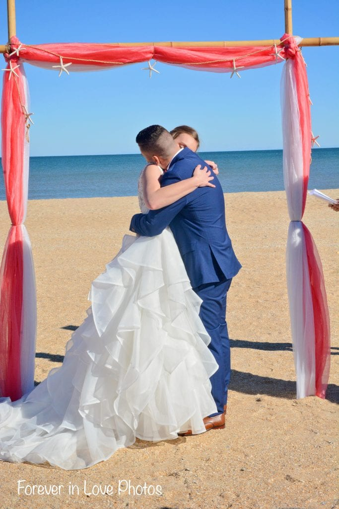 Bride and groom at beach wedding ceremony in Florida