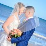 Couple under wedding veil at St. Augustine wedding