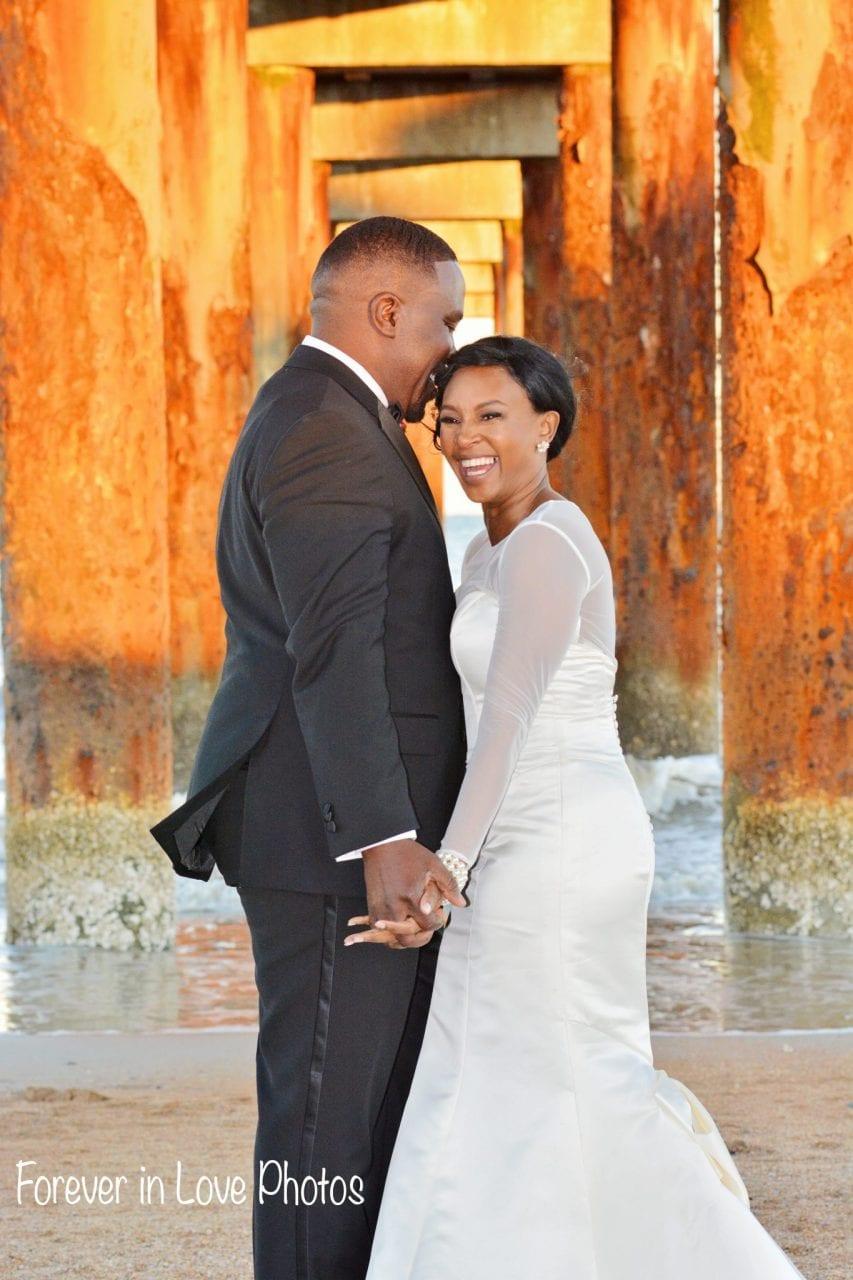 Couple just married on the beach under the Daytona Beach pier