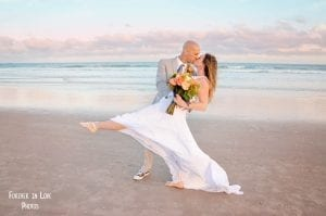 Cocoa Beach Weddings during sunset in Florida.
