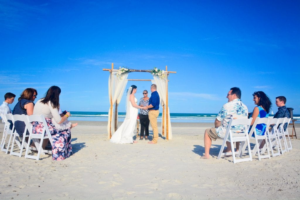 Affordable Beach Wedding packages in Florida with a natural beach wedding canopy, chairs, photographer and aisle-way.