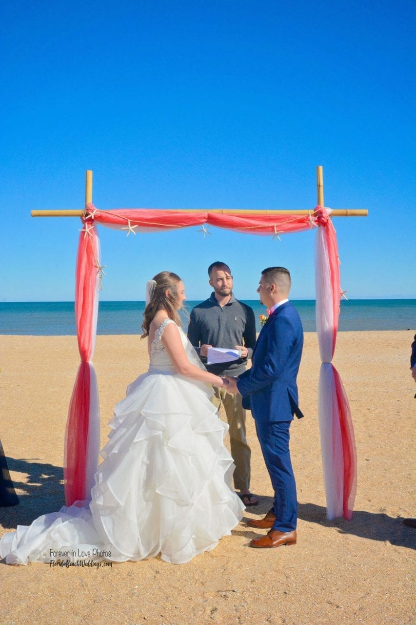 Couple on the beach at the altar