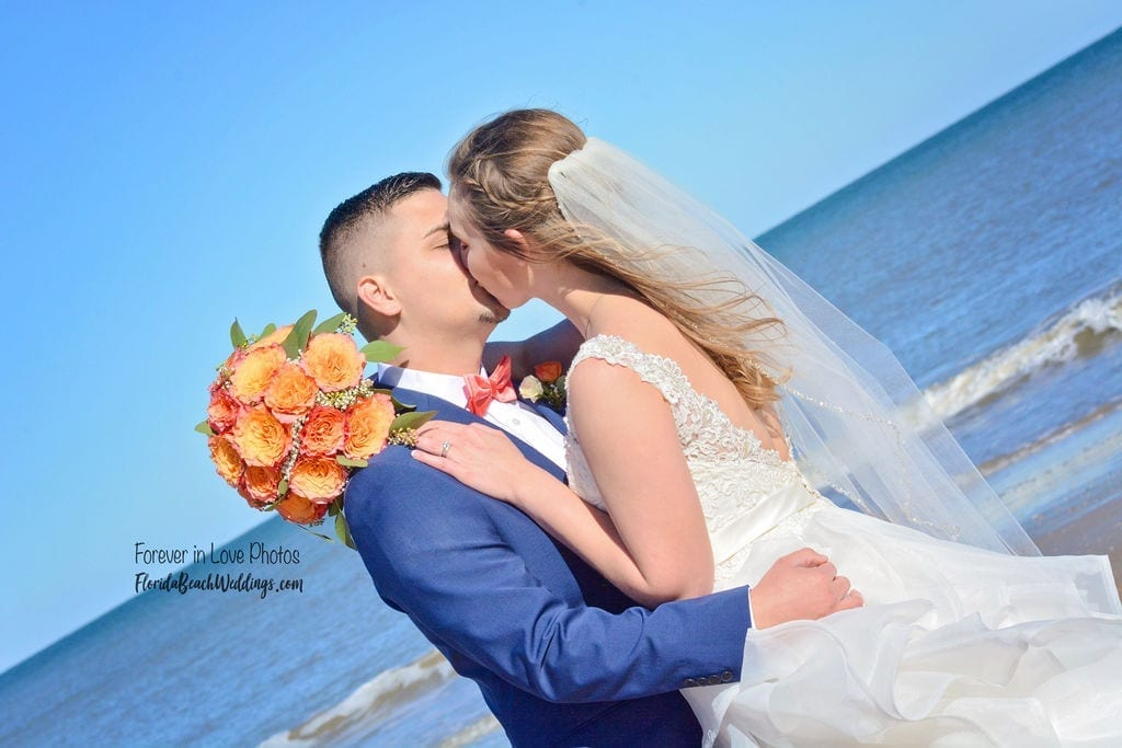 Couple kissing during Florida Beach Wedding ceremony