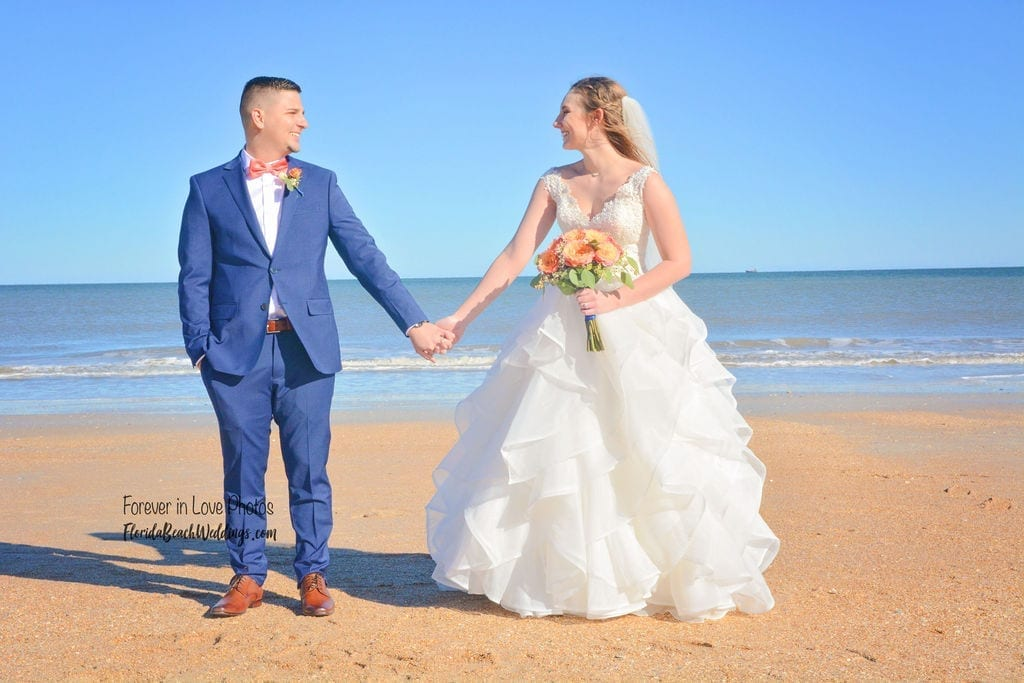 Daytona Beach wedding couple holding hands after vow ceremony