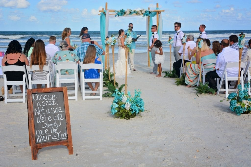 Teal Distinctive Design Package beach wedding with guests in chairs
