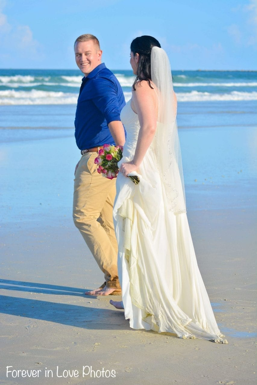 Couple just married walking on the beach