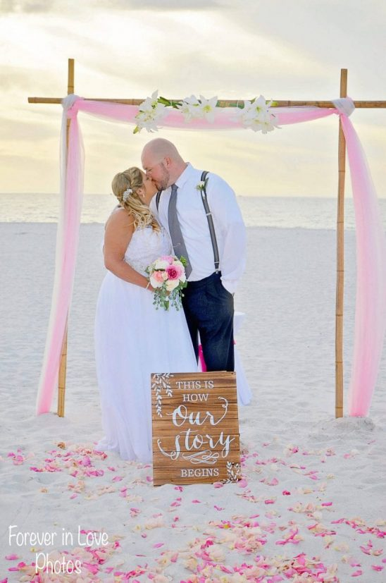 Wedding couple kissing on Clearwater Beach