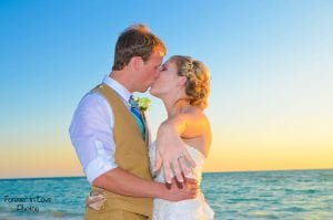 Clearwater Beach Weddings with blue water, white sand and beautiful photos.
