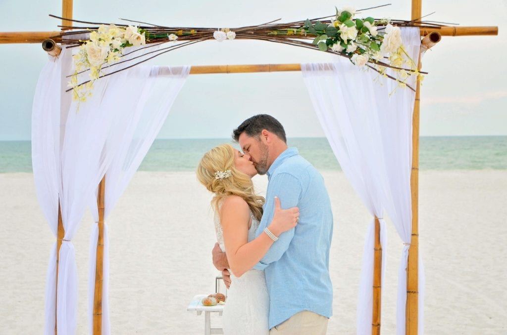 Treasure Island Beach Elopements with a natural bamboo canopy.