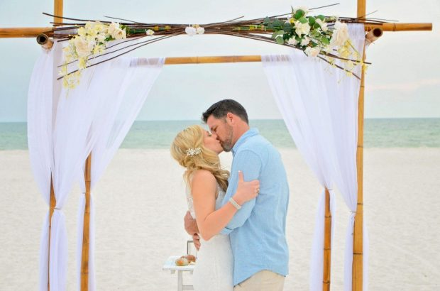 Pass-A-Grille Beach Elopements with a natural bamboo canopy.