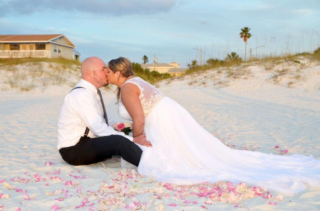 Clearwater beach wedding couple kissing.