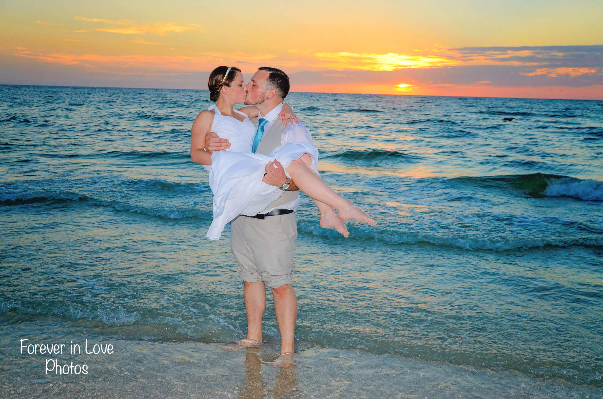Wedding couple in surf on St. Pete Beach FL