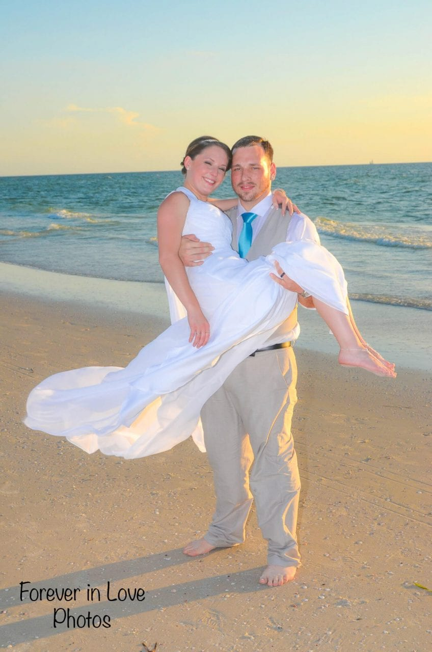 Couple just married in water on Siesta Key Beach