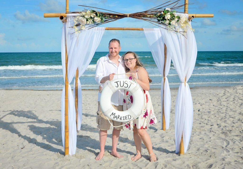Cocoa Beach Wedding with couple eloping under canopy.