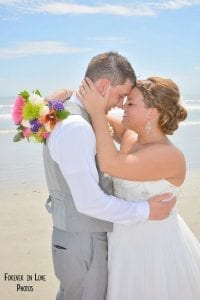 A sweet moment for our bride and groom during one of our Cocoa Beach Weddings.