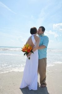 A bride and groom share a kiss during one of our Cocoa Beach Weddings.