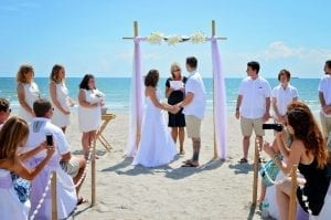 Cocoa Beach Weddings with all white decor and neutral color tones.