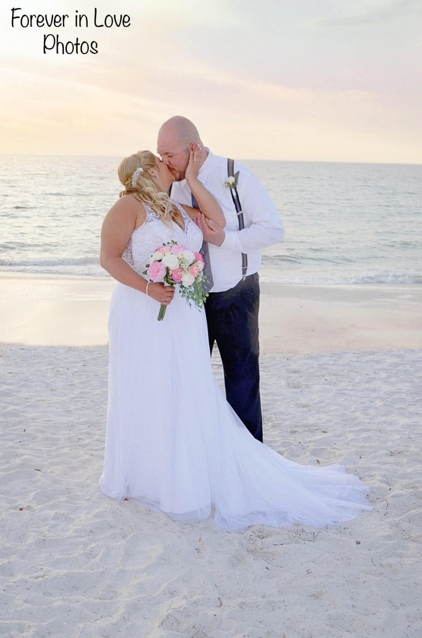 Wedding couple kissing on Treasure Island Gulf Beach