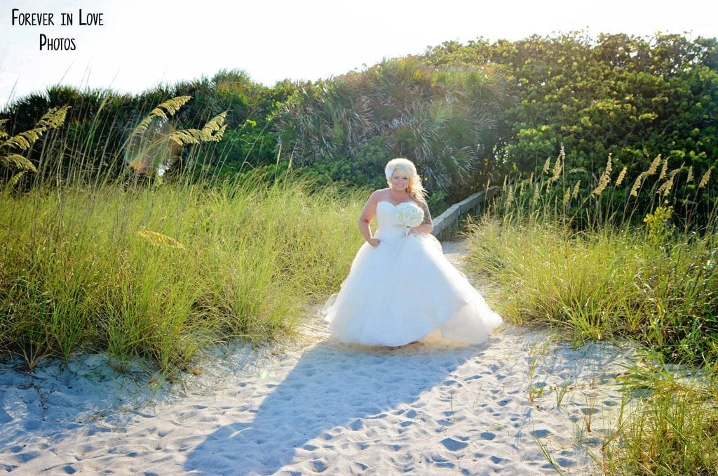 A bride walks down the beautiful aisleway of our Cocoa Beach Weddings.