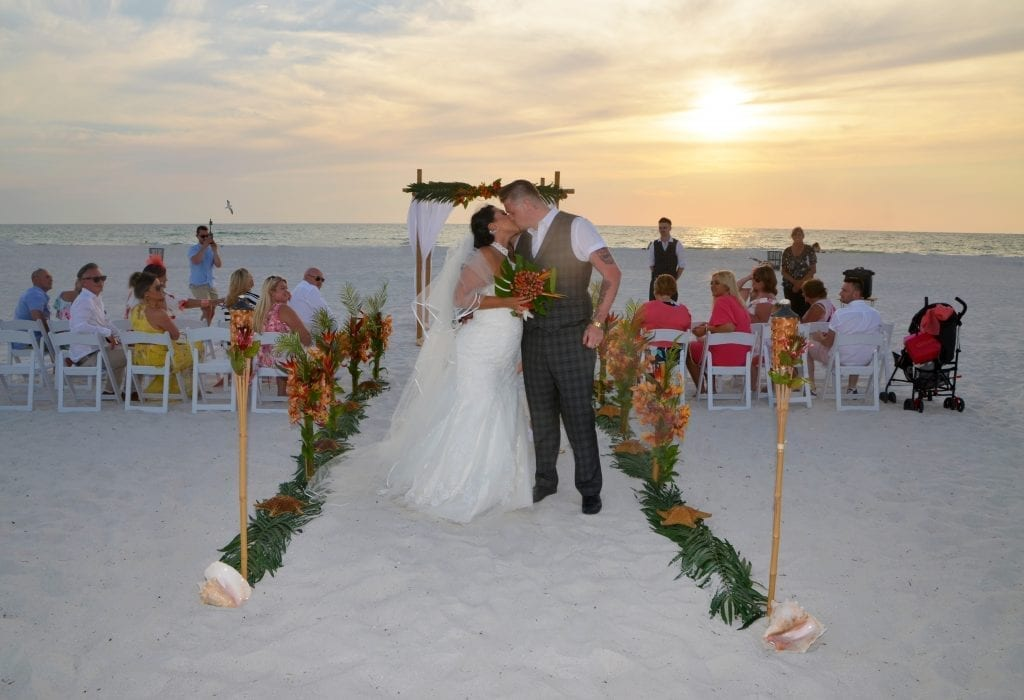 A sunset kiss in front of one of our beach wedding packages in Clearwater Florida.