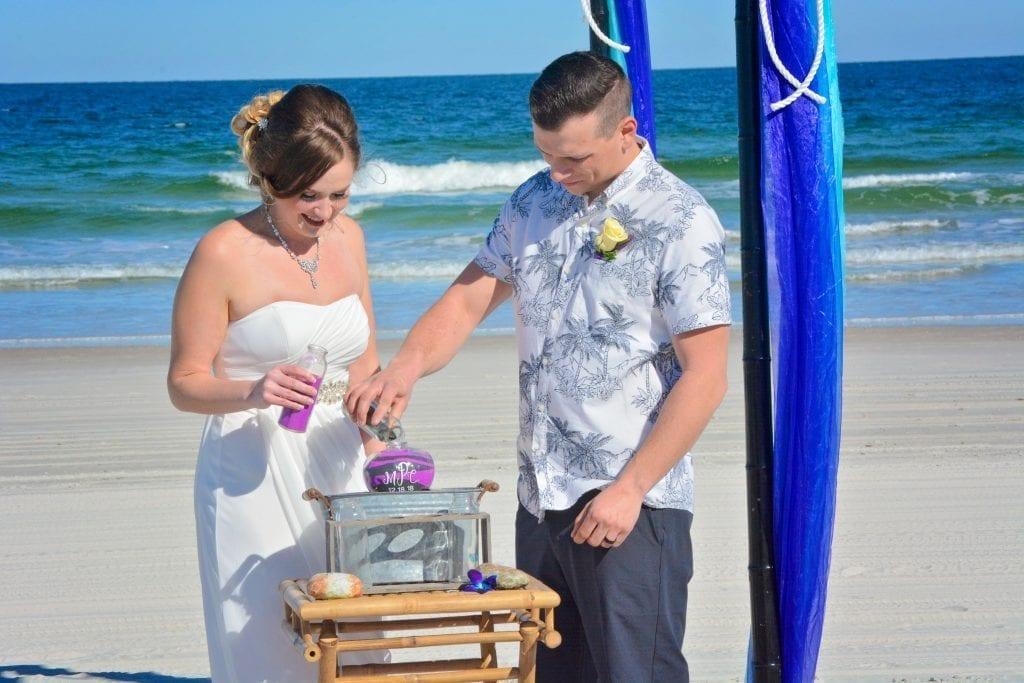 At a Florida Beach Wedding Ceremony The bride and groom finish their sand ceremony.