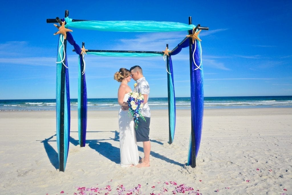 Blue Daytona Beach Weddings with flower petals and black bamboo canopy