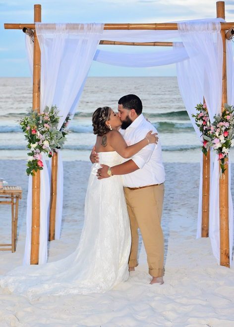 Classic Distinctive Design Gulf Beach Wedding couple kissing