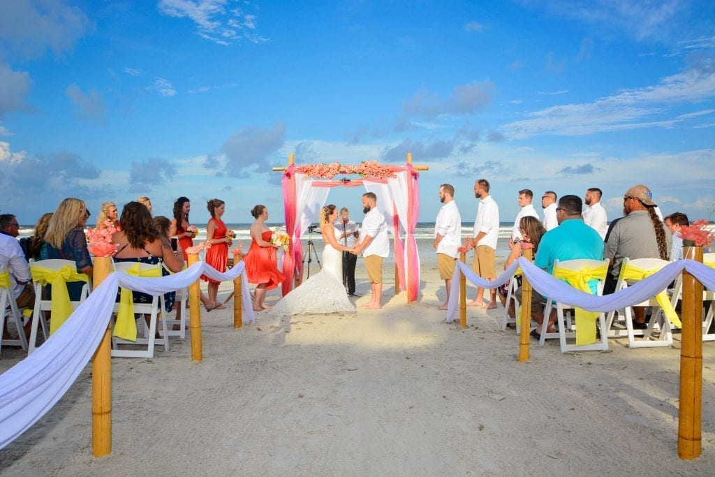 "At one of our Destination beach wedding packages in Florida the couple says ""I Do""."