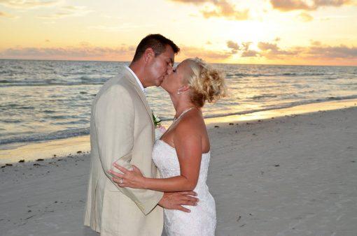 Wedding couple kissing on Lido Beach, Florida