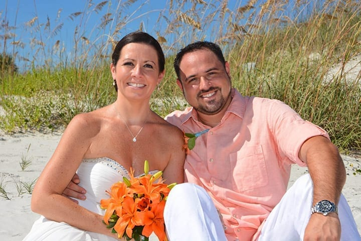 Beach Wedding couple after vows in New Smyrna sand dunes