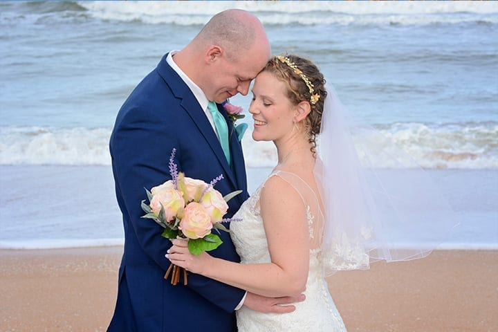 Ormond Beach Wedding Couple hugging by the ocean