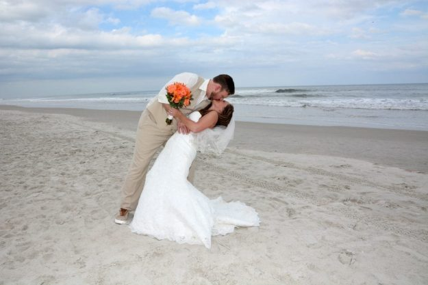 Bride and groom kissing at Ormond Beach wedding, Florida
