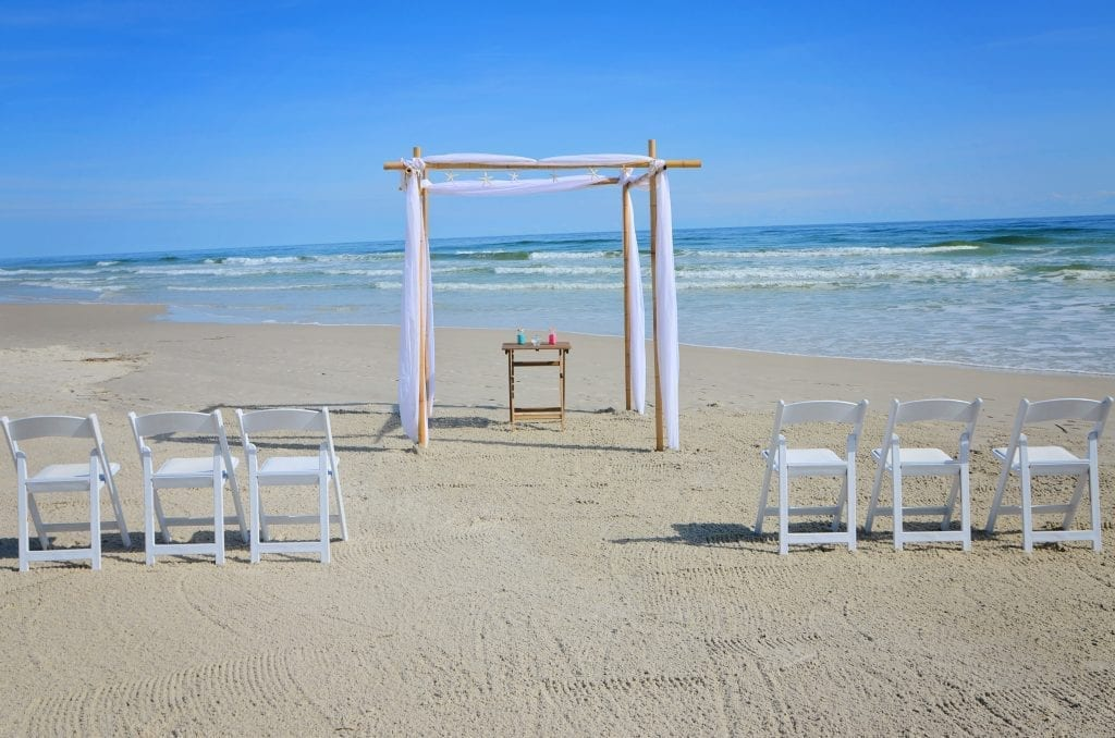 Affordable Florida Beach Weddings with bamboo canopy, chairs, officiant, photography and more in Florida. Elope in Florida with this style.