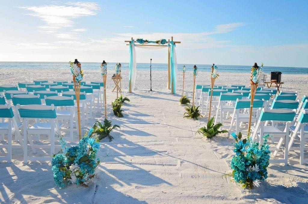 Teal wedding arch and chairs on Siesta Key Beach