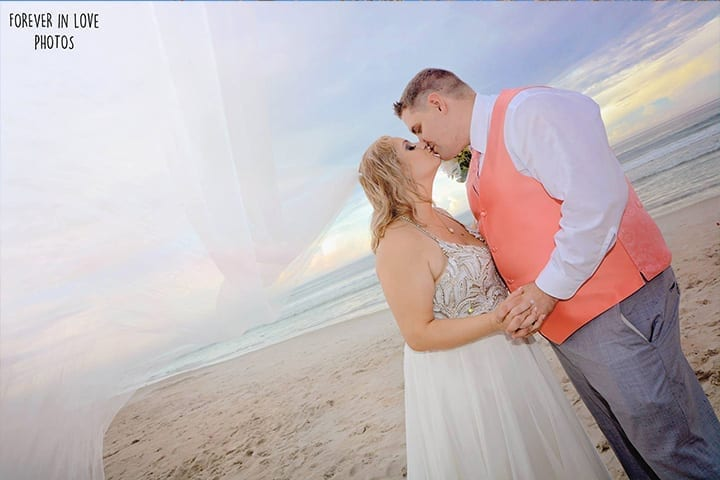 Couple kissing after Florida beach wedding ceremony