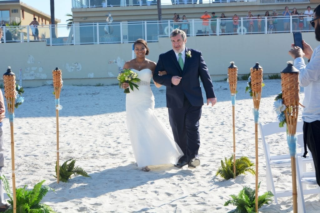 Our Daytona Beach Weddings can take place right behind your hotel on the beach. This beach wedding in Daytona was performed at the Shores Resort and Spa.
