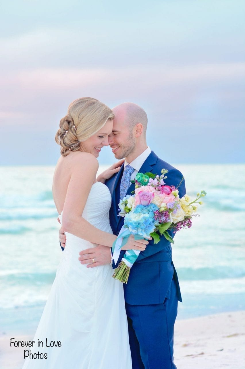 Couple married on Siesta Key Beach at sunset wedding