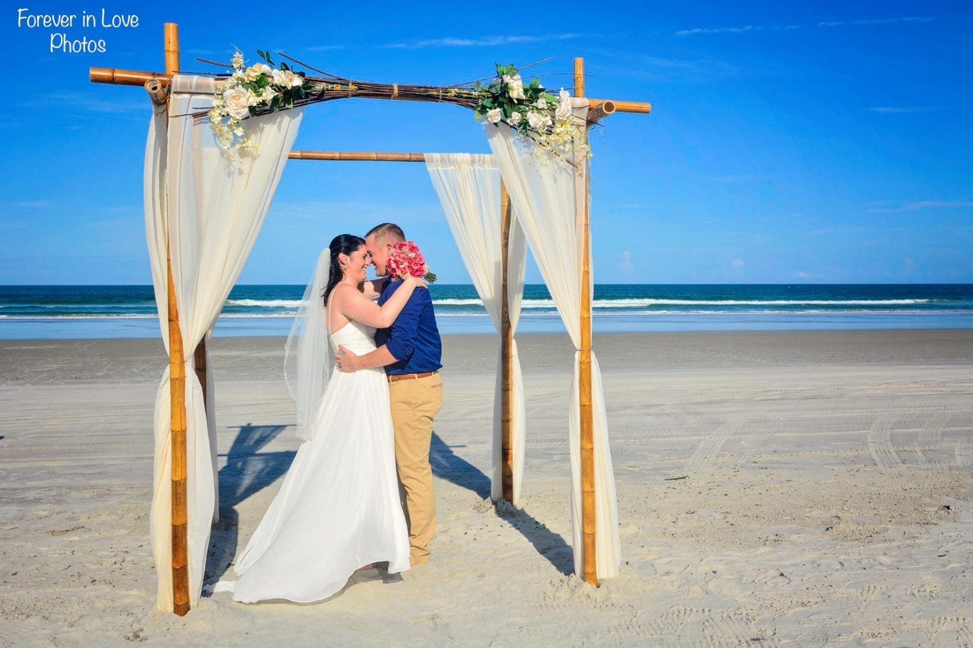 Wedding couple kissing after vows on South Beach
