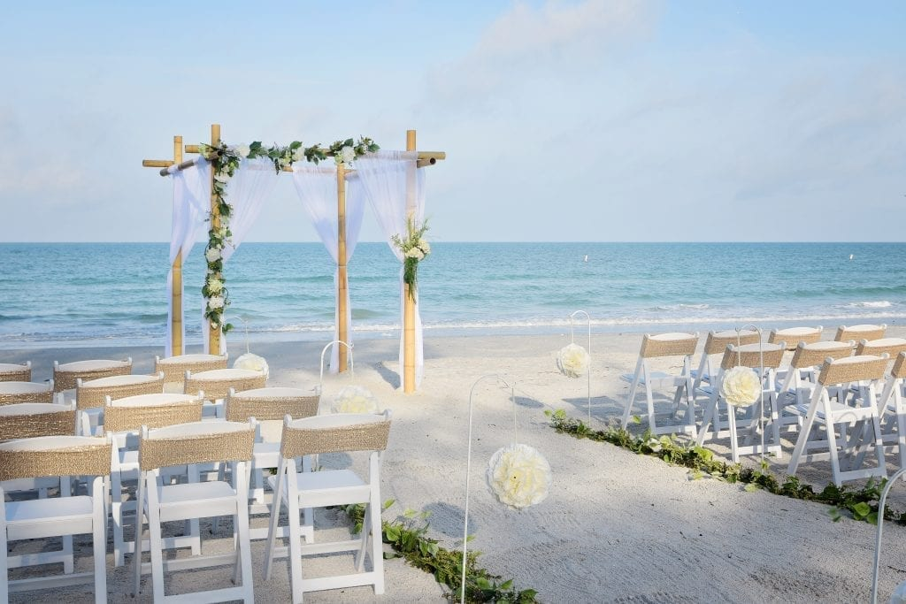 Altar with flowers on the beach for wedding