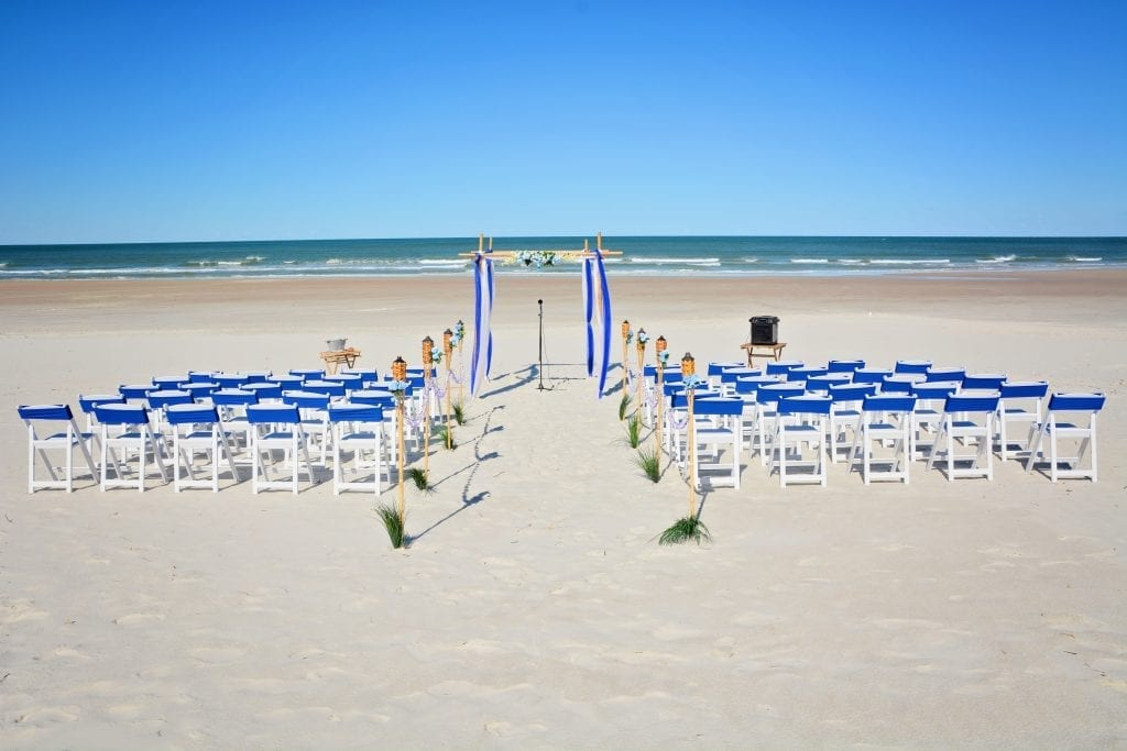 Royal blue and white beach wedding setup on Daytona Beach, FL