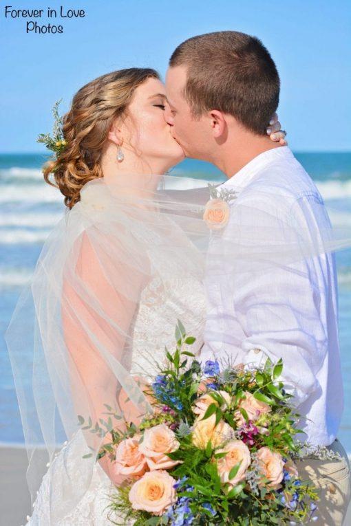 Couple kissing at their Daytona Beach wedding