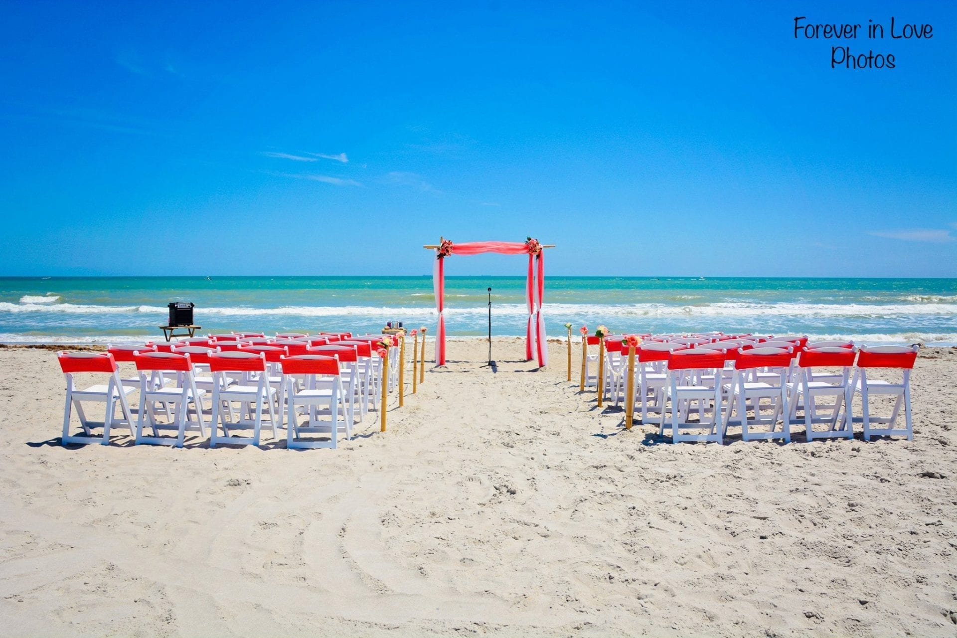 Coral Distinctive Design Wedding arch on Destin Beach Florida