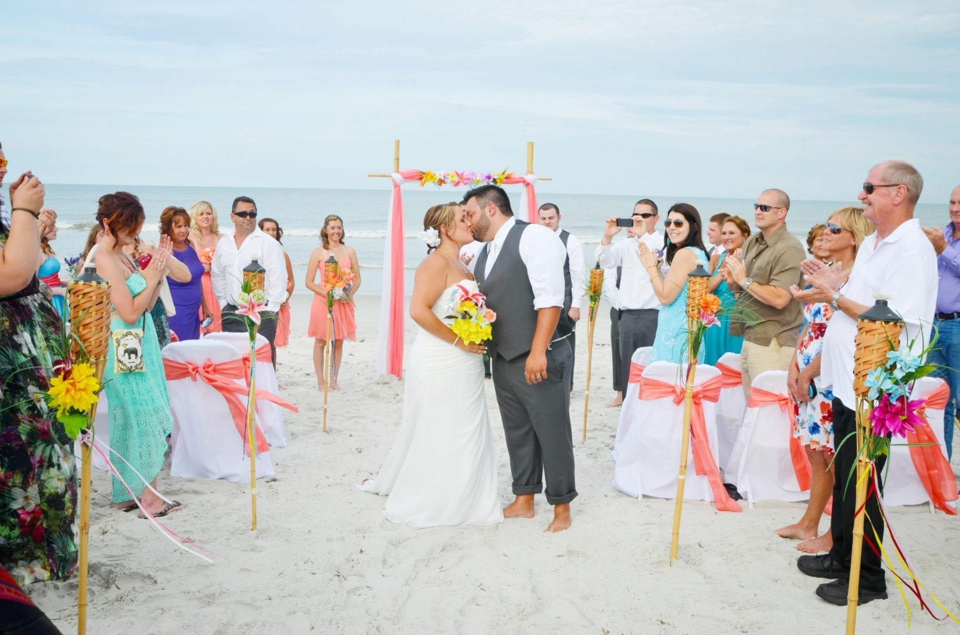 Beach Wedding Guests celebrating the newly married couple at their beach wedding in Florida