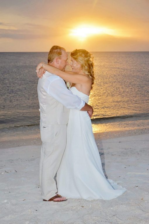 Couple hugging on beach at sunset wedding Fort Myers beach