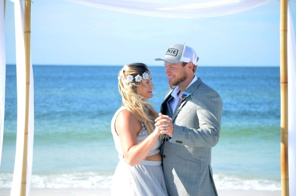 Sharing a first dance on the beach for their Florida Beach Elopement ceremony