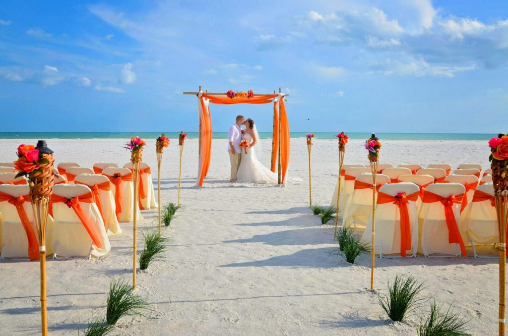 Bride and groom kissing after beach wedding in Clearwater, Florida