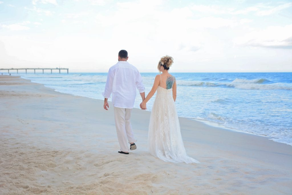 St. Augustine, Florida beach wedding couple walking on sand