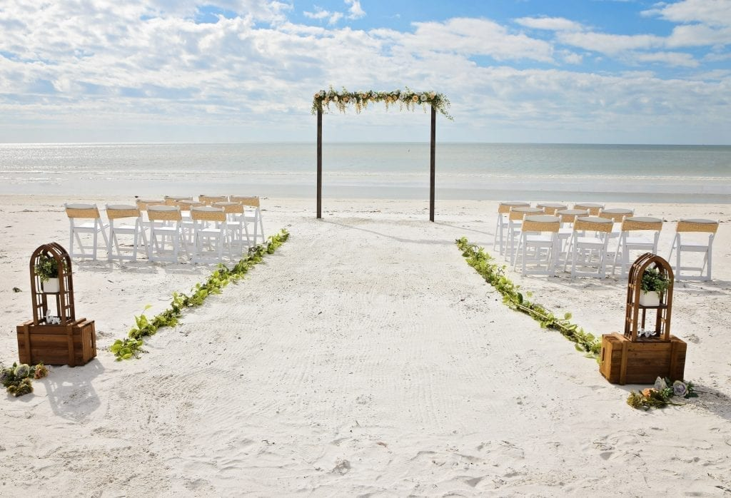 Wooden arch on the beach for your beach wedding decor.