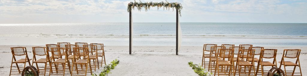 Rustic Beach Weddings in Florida with elegant floral designs